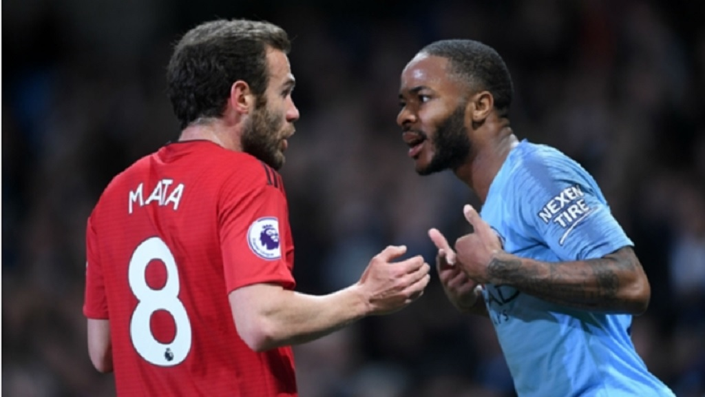 Juan Mata and Raheem Sterling clash late in the Manchester derby.