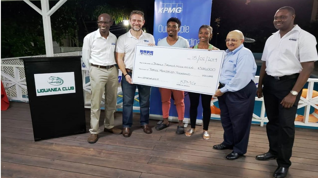 Tarun Handa, (second right) Managing Partner for KPMG in Jamaica presents a sponsorship cheque for $300,000 to Chris Hind, (second left) President of the Jamaica Squash Association for the KPMG Squash. The presentation took place a the Liguanea Club. Sharing in the moment are Nigel Chambers, KPMG's Partner Audit and Head of Markets, (far left) players Tahjia Lumley (third left) and Larissa Wiltshire (third right) as well as Damian Reid, KPMG's Manager Audit.