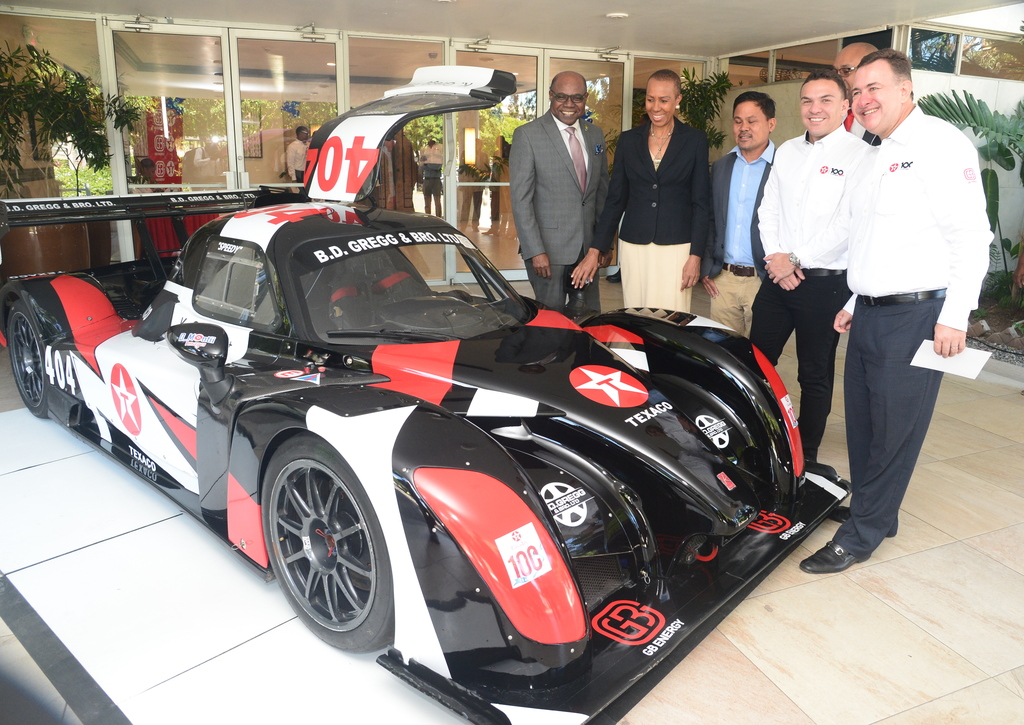 From left to right: Tourism Minister Tourism Minister, Energy Minister Fayval Williams, Jamaica Gasolene Retailers Association President Gregory Chung, race car driver Kyle Gregg and GB Energy Jamaica CEO Mauricio Pulido examine a Team GB-branded race car at Texaco Jamaica's Centennial Celebrations. (Photo: Collin Reid)