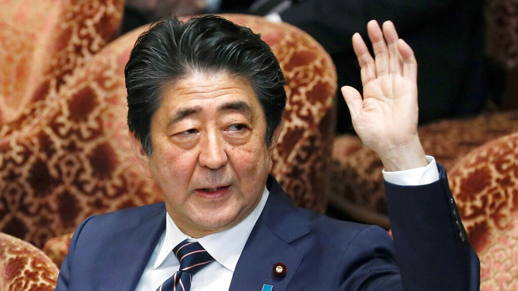 Japanese Prime Minister Shinzo Abe raises his hand during a parliamentary session at the Lower House in Tokyo, Monday, Feb. 18, 2019. (Kyodo News via AP)