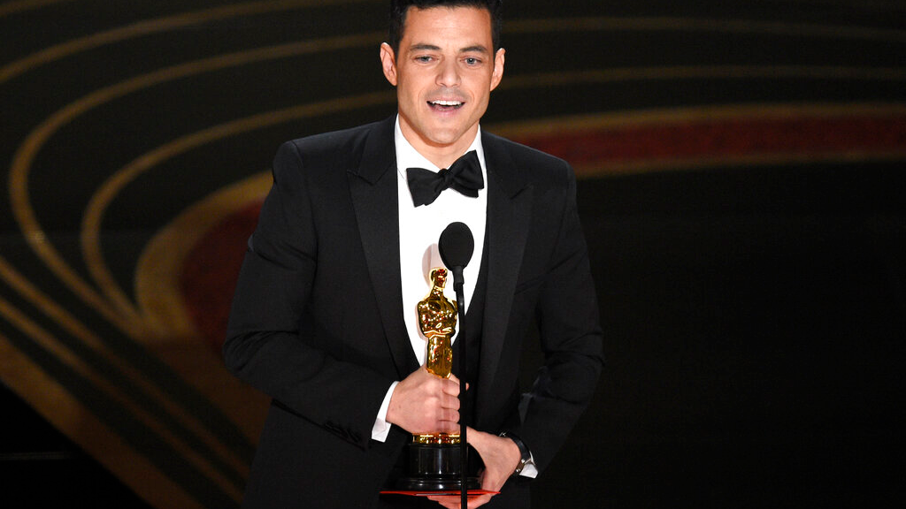 "Rami Malek accepts the award for best performance by an actor in a leading role for ""Bohemian Rhapsody"" at the Oscars on Sunday, Feb. 24, 2019, at the Dolby Theatre in Los Angeles. (Photo by Chris Pizzello/Invision/AP)"