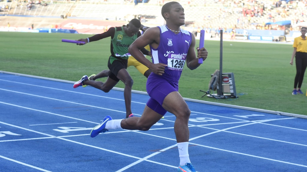 Adrian Kerr guides KC to an easy victory in the Boys' Class 2 4x100m relays ahead of Calabar and St Jago at the Puma Gibson McCook Relays at the National Stadium on Saturday, February 23, 2019. (PHOTOS: Marlon Reid)