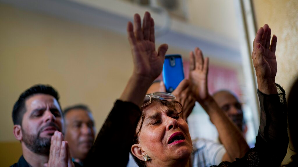 Evangelicals pray during a Mass at a church in Havana, Cuba, Sunday, Jan. 27, 2019. (AP Photo/Ramon Espinosa)