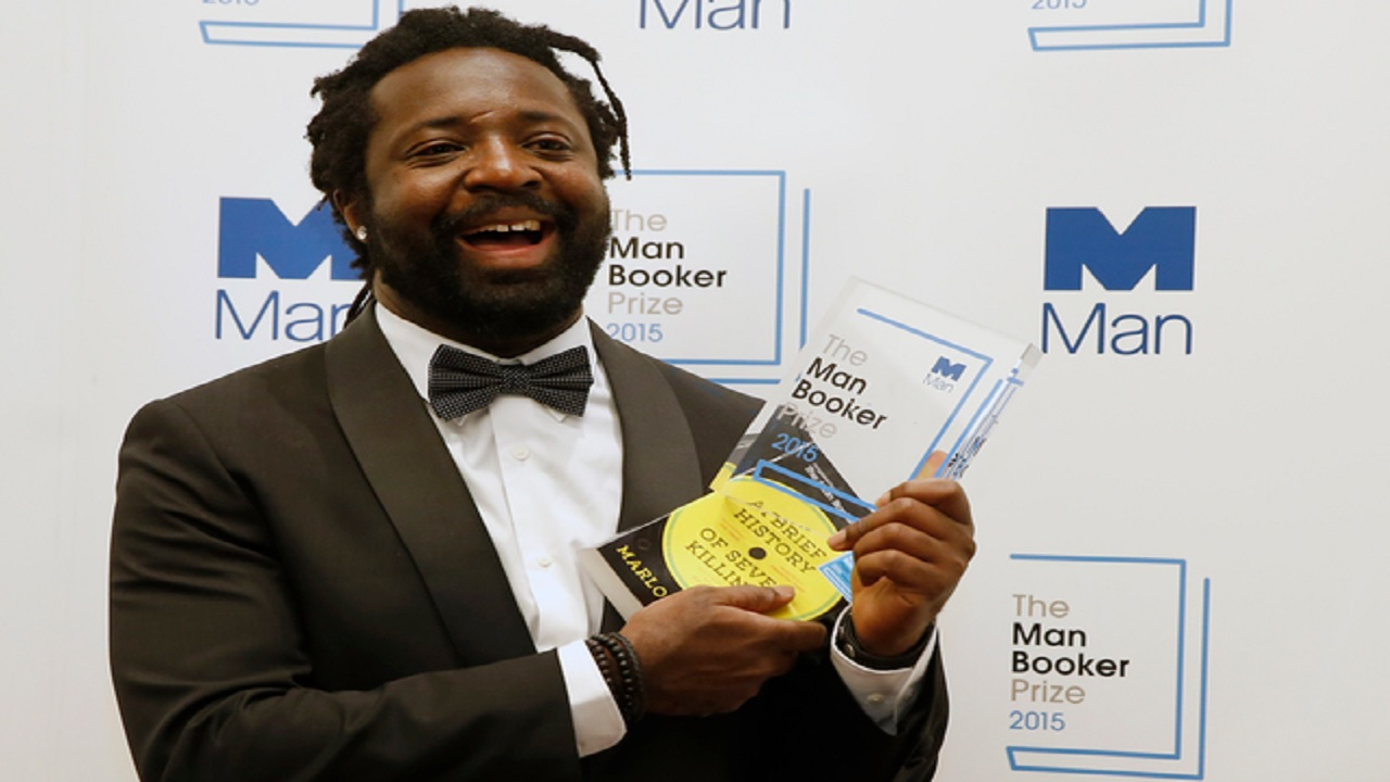 "In this October 13, 2015 file photo, Jamaican author Marlon James poses with the award after his book ""A Brief History of Seven Killings,"" was named as winner of the 2015 Booker Prize 2015 for Fiction in London. Author of four novels, the 48-year-old James has made an art of ""finding what would rather stay lost,"" as he writes in his new work, ""Black Leopard, Red Wolf."" (AP Photo/Alastair Grant, File)"
