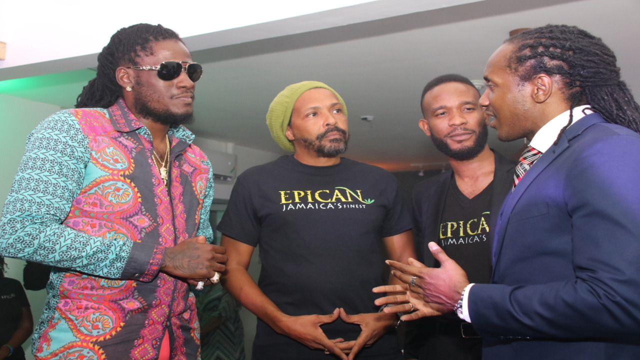Minister of State in the Ministry of Culture, Gender, Entertainment and Sport, Alando Terrelonge (right) makes a point in discussion with dancehall star Aidonia and Epican executives Dwayne McKenzie and Jermaine Bibbons. (PHOTOS: Llewellyn Wynter)