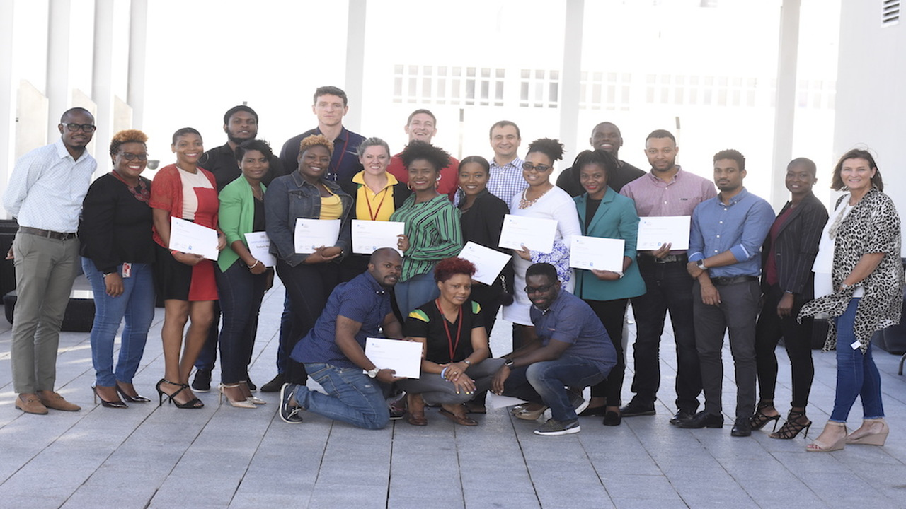 Digicel Group staff members pose with their iCreate certificates after an award ceremony at the communication leader's headquarters in Kingston on Friday. (PHOTOS: Marlon Reid)
