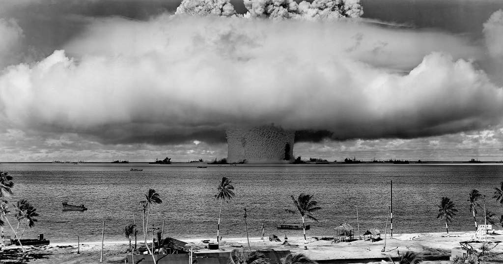 "The ""Baker"" explosion, part of Operation Crossroads, a nuclear weapon test by the United States military at Bikini Atoll, Micronesia, on 25 July 1946. The wider, exterior cloud is actually just a condensation cloud caused by the Wilson chamber effect, and was very brief. The water released by the explosion was highly radioactive and contaminated many of the ships that were set up near it. Photo: Wikipedia."