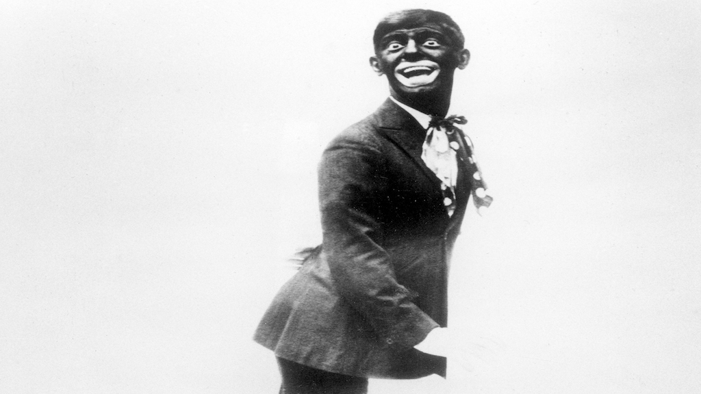 "This 1920s image shows comedian Eddie Cantor wearing blackface while performing ""If You Knew Susie."" Blackface minstrelsy is considered by some to be the first uniquely American form of entertainment. White men would darken their faces to create caricatures of black people, including large mouths, lips and eyes, woolly hair and coal-black skin. (AP Photo/File)"