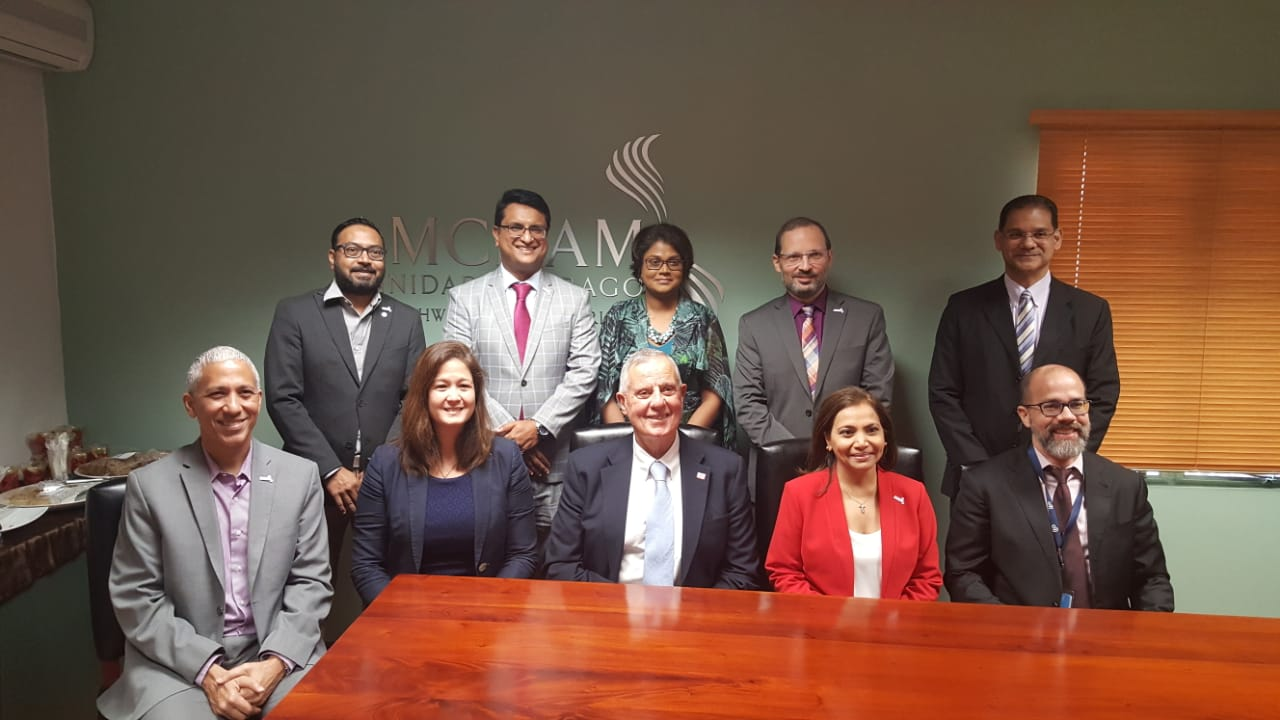 Members of the AMCHAM T&T Board with US Ambassador Joseph N Mondello. Photo courtesy AMCHAM T&T.