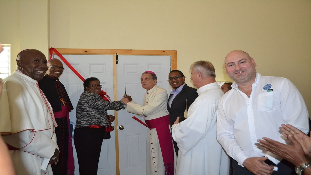From left to right:  Most Rev. Burchell McPherson, Bishop of Montego Bay; Most Rev. Kenneth D.O. Richards, Archbishop of Kingston; Beryl Rochester, Custos of St Elizabeth; Rev. Charles Dufour, Archbishop Emeritus of Kingston and Floyd Green MP for South West St Elizabeth and FFP Director of Distribution Services Craig Moss-Solomon at the dedication ceremony.