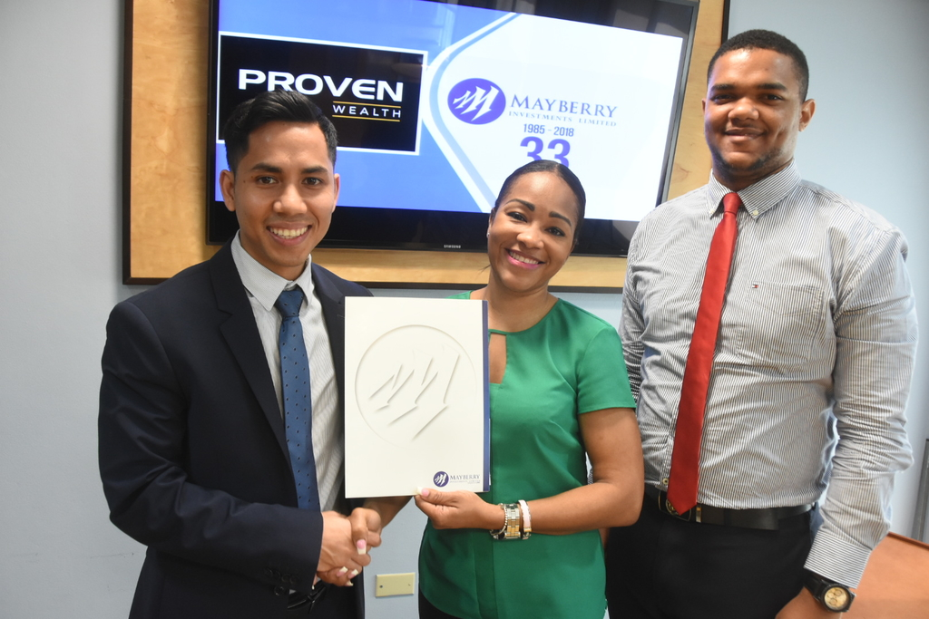 Christopher Yeung (left), Head of Treasury and Corporate Finance, PROVEN Wealth Limited, Mckoy Jackson, Senior Manager of Investment Banking and Tania Waldron-Gooden, Director of Investment Banking, Mayberry Investments Limited.