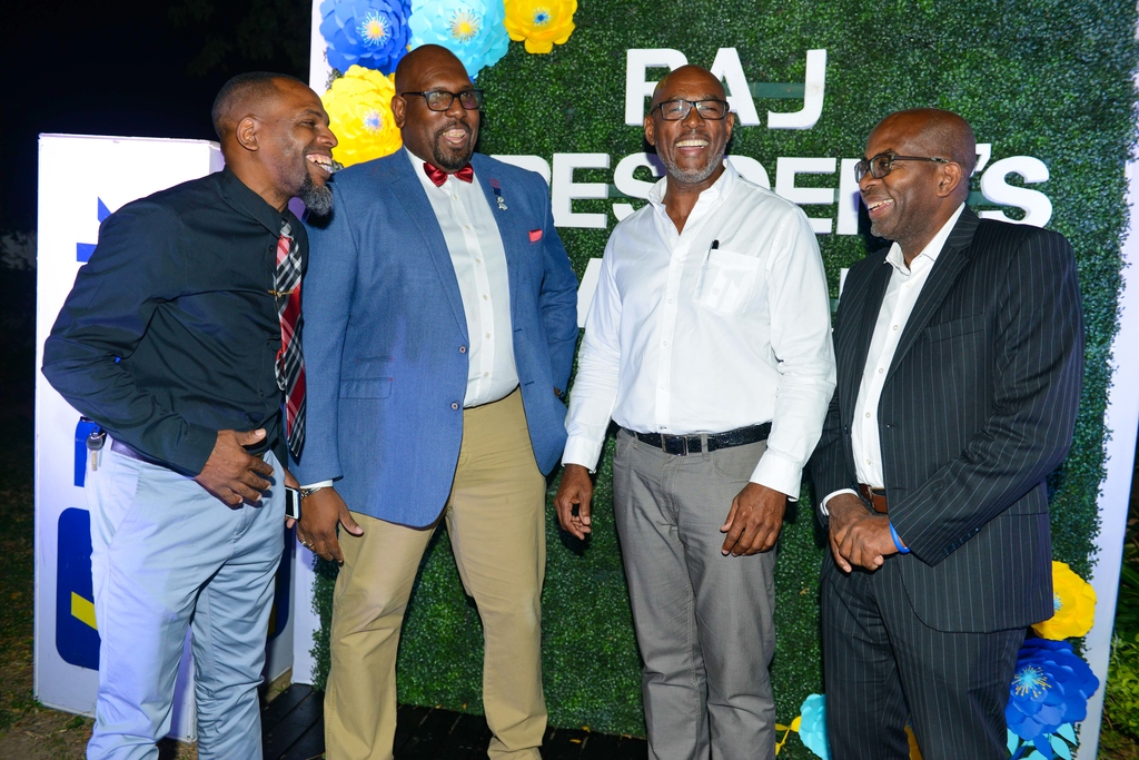 Howard Johnson Jr, immediate past president, Realtors Association of Jamaica (RAJ); Andrew James, new RAJ president, Andrew James; Gregory Mayne, general manager, Realty Limited; Curtis Martin, managing director, JN Bank, share a laugh during the RAJ President's Mingle.