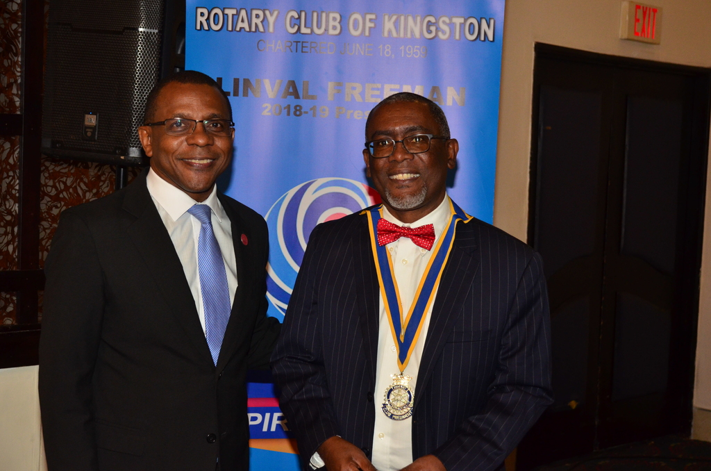 Courtney Campbell (left) President & CEO, Victoria Mutual Group is greeted on arrival at the Rotary Club of Kingston's luncheon meeting by Club President Linval Freeman (right).