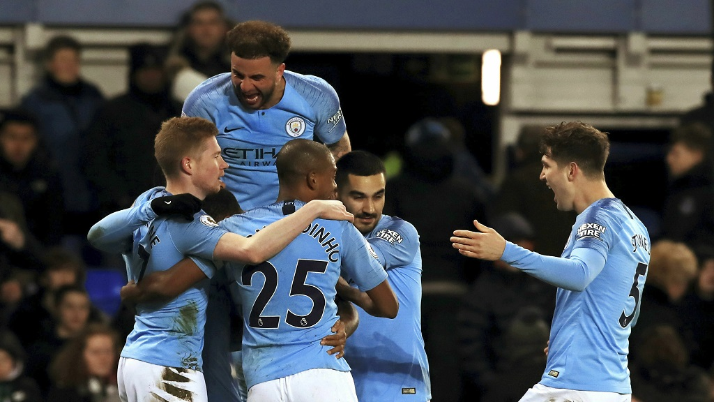 Manchester City's Gabriel Jesus, obscured, celebrates with teammates after scoring his side's second goal of the game against Everton during an English Premier League football match at Goodison Park, Liverpool, England, Wednesday, Feb. 6, 2019.
