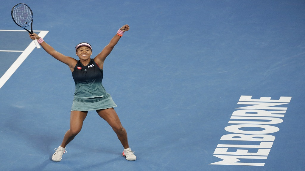 Japan's Naomi Osaka celebrates after defeating Karolina Pliskova of the Czech Republic in their semifinal at the Australian Open tennis championships in Melbourne, Australia, Thursday, Jan. 24, 2019.
