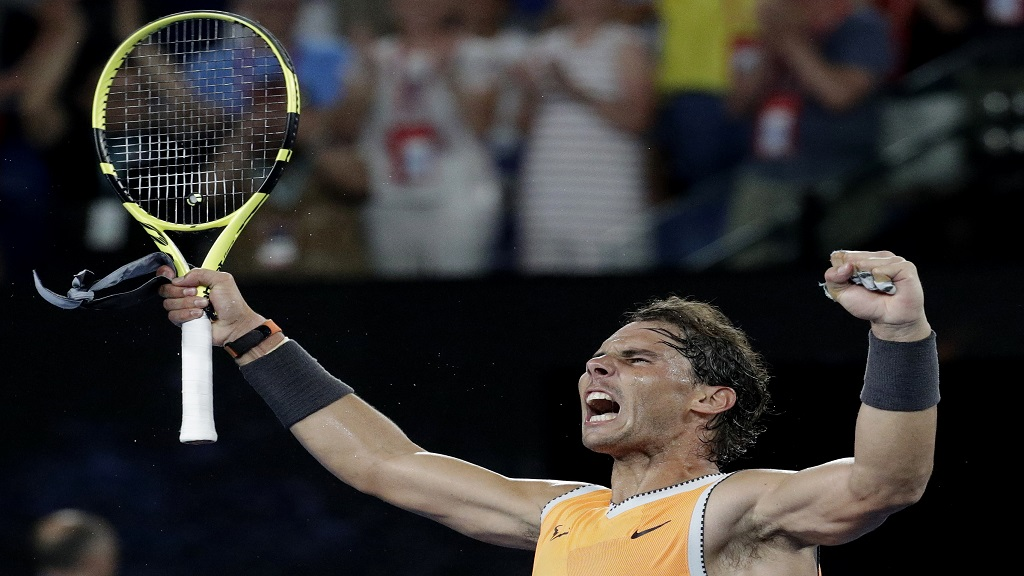 Spain's Rafael Nadal celebrates after defeating Greece's Stefanos Tsitsipas in their semifinal at the Australian Open tennis championships in Melbourne, Australia, Thursday, Jan. 24, 2019.