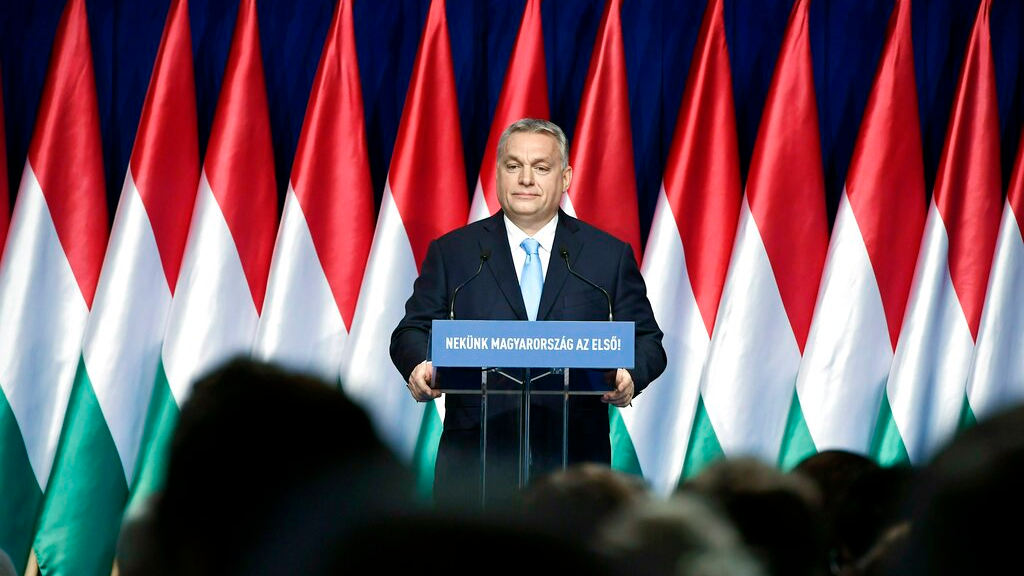 "Hungarian Prime Minister Viktor Orban delivers his annual ""State of Hungary"" speech in Budapest, Hungary, Sunday, Feb. 10, 2019. The inscription reads: ""For us Hungary is the first!"""