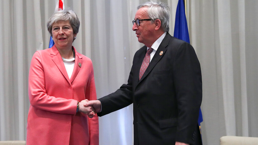 British Prime Minister Theresa May, left, shakes hands with European Commission President Jean-Claude Juncker during a bilateral meeting on the sidelines of an EU-Arab League summit at the Sharm El Sheikh convention center in Sharm El Sheikh, Egypt, Monday, Feb. 25, 2019. Leaders from European Union and Arab League countries met for a second day in the Egyptian resort city of Sharm el-Sheikh to discuss migration, security and business deals. (AP Photo/Francisco Seco, Pool)