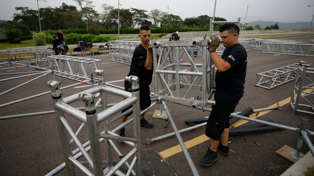 "Workers build the stage for an upcoming concert coined: ""Concert for the freedom of Venezuela"" on the Colombian side of the Tienditas International Bridge on the outskirts of Cucuta, Colombia, on the border with Venezuela, Monday, Feb. 18, 2019. Billionaire Richard Branson is organizing the concert on Feb. 22 featuring Spanish-French singer Manu Chao, Mexican band Mana, Spanish singer-songwriter Alejandro Sanz and Dominican artist Juan Luis Guerra. (AP Photo/Fernando Vergara)"