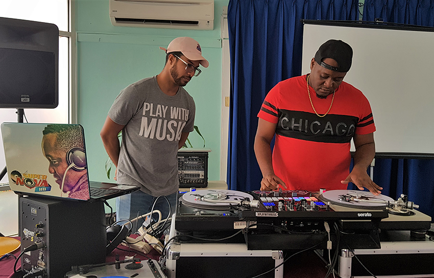 Justin 'Jus Jay' King (left) and Paul 'De Vibes Minister SuperNova' Harewood during the workshop. (J.Weekes/BGIS)