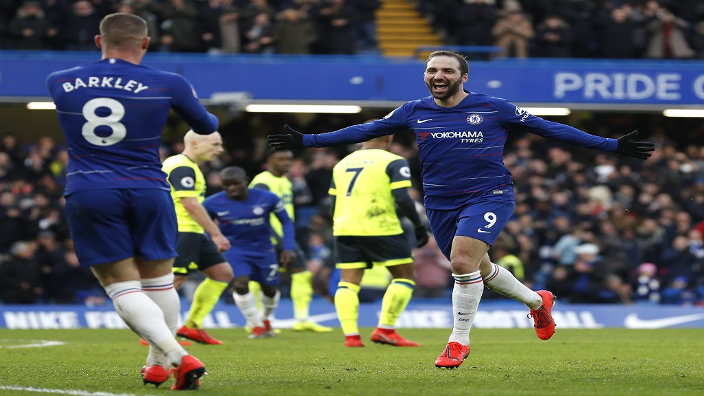 Chelsea's Gonzalo Higuain celebrates after scoring his side's fourth goal during the English Premier League football match against Huddersfield Town at Stamford Bridge stadium in London, Britain, Saturday, Feb. 2, 2019.