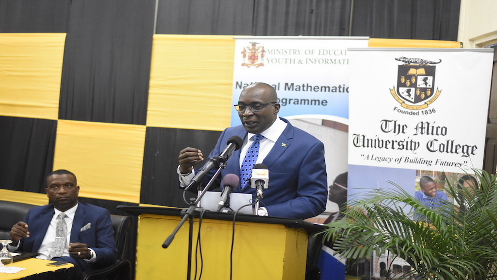 Education Minister Ruel Reid speaking at last Wednesday's launch of the Mico International Mathematics Teaching Summit. (PHOTOS: Marlon Reid)