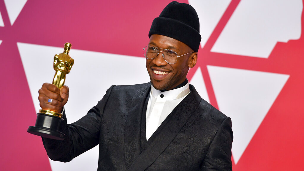 "Mahershala Ali poses with the award for best performance by an actor in a supporting role for ""Green Book"" in the press room at the Oscars on Sunday, Feb. 24, 2019, at the Dolby Theatre in Los Angeles. (Photo by Jordan Strauss/Invision/AP)"