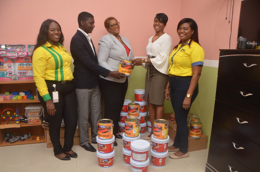 Supreme Ventures President and CEO, Ann-Dawn Young Sang (2nd right) presents a donation under Supreme Ventures Foundation's Simply Vested In Love outreach to Yasmin Solomon Russell Fund Development & Communications Advisor, SOS Children's Villages Jamaica and Marvin Simpson, manager of the Stony Hill SOS Children's Village. Also present are Stephanie Todd, Communications Officer (far left) and Sherdene Davy, Supervisor of the Supreme Ventures Half Way Tree Retail Centre. Supreme Ventures.