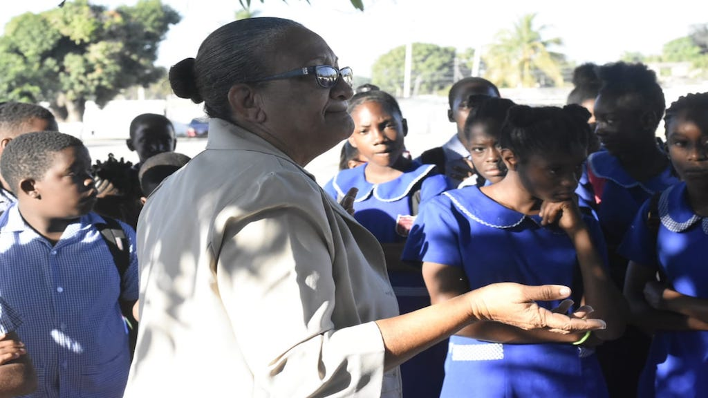 Juanita Green, vice-principal of Swallowfield Primary, talks to students ahead of the sitting of the Ability Test component of the Primary Exit Profile on Tuesday morning. (PHOTOS: Marlon Reid)