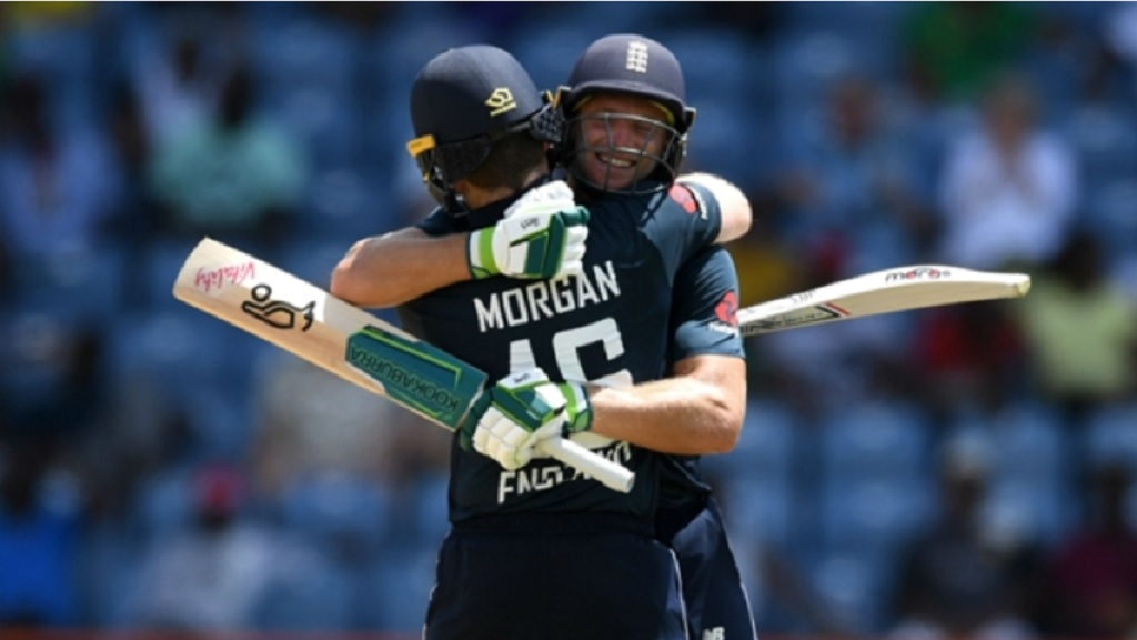 Jos Buttler and Eoin Morgan embrace in Grenada.