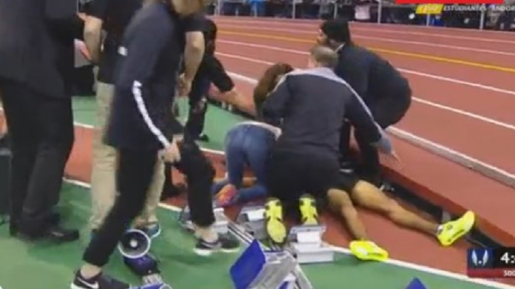 Kemoy Campbell being attended to after collapsing while setting the pace in the men's 3000m at the Millrose Games in New York.