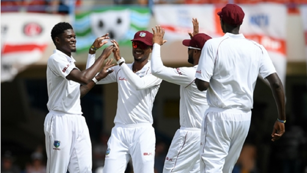 West Indies players celebrate an Alzarri Joseph wicket.