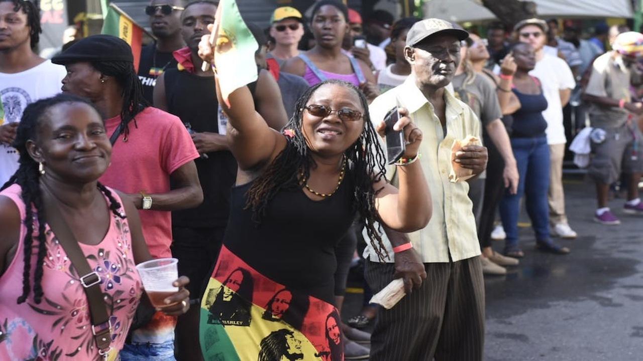 Patrons enjoy Bob Marley birthday activities at the Bob Marley Museum in St Andrew earlier this week. (PHOTO: Marlon Reid)