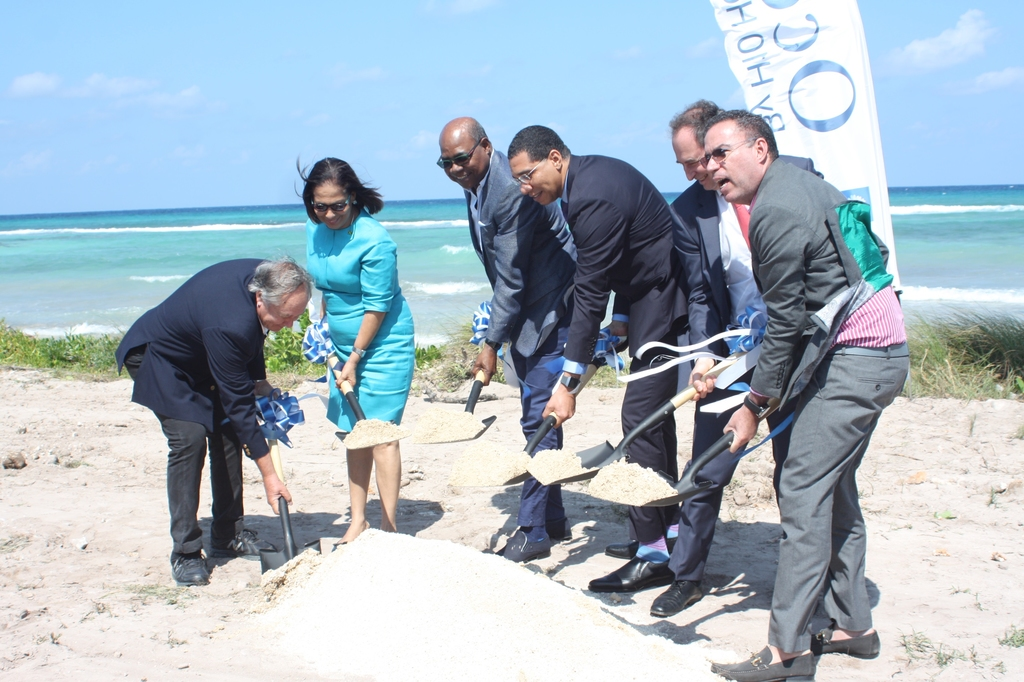 Prime Minister Andrew Holness (3rd right) is flanked by from left: Trelawny custos Paul Muschett, Labour Minister Shahine Robinson, Tourism Minister Edmund Bartlett, Antonio Hernandez, director of H10 Hotel and Daryl Vaz, minister without portfolio in the Ministry of Economic Growth and Job Creation participate in official ground breaking of Ocean Coral Spring Hotel by H10 Hotels on Wednesday.
