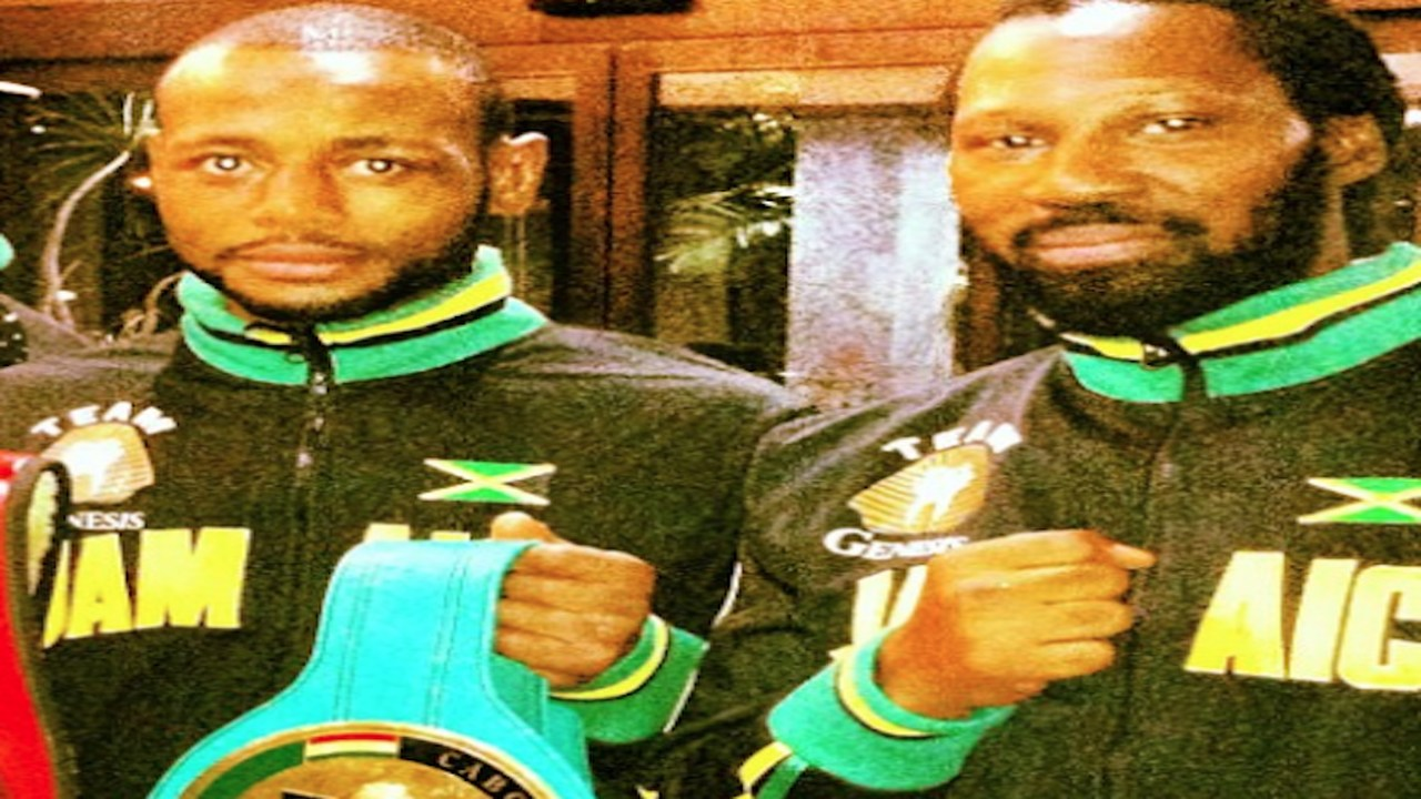 Jamaican boxer Sakima Mullings (left) with late trainer Christopher Brown.