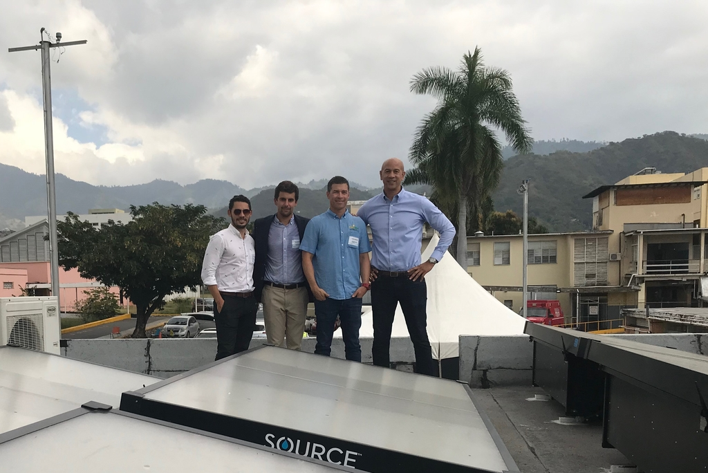 From left: Dr. Masao Ashtine, Lecturer-Renewable Energy Systems, University of the West Indies; Nate DeFlavio, Business Development Manager - Caribbean Islands, Zero Mass Water; Jason Robinson, CEO, Solar Buzz Jamaica and Zachary Harding, Founder and CEO, Hyperion Equity LLC, take a photo on the roof of the University Hospital of the West Indies Children's Ward following the successful installation.