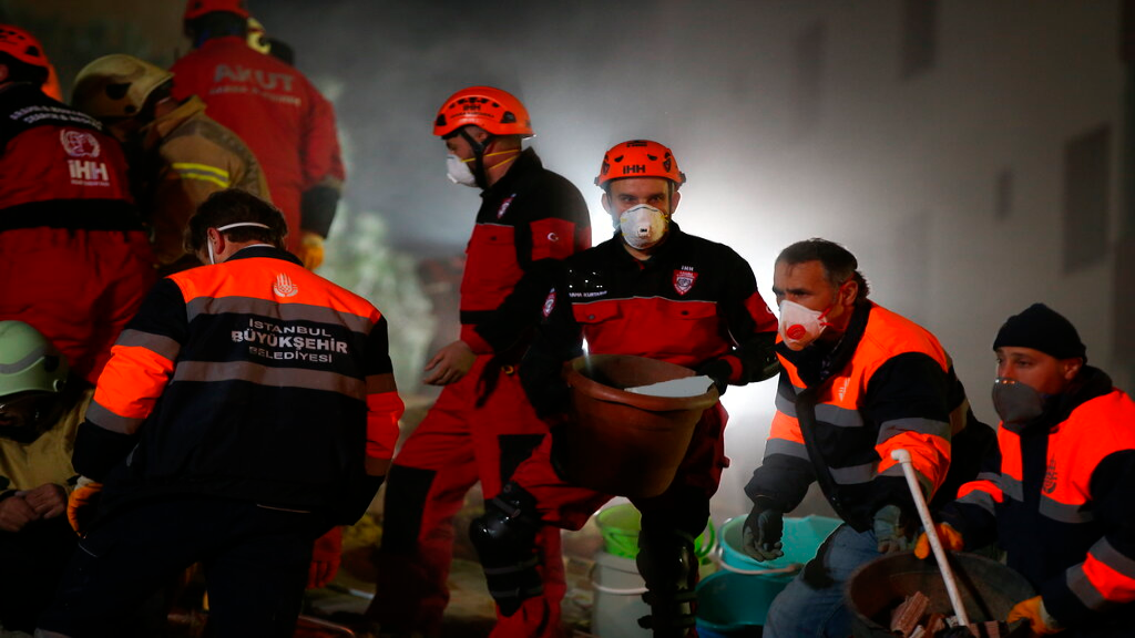 Rescue workers search for survivors at the rubble of an eight-story building which collapsed in Istanbul, late Wednesday, Feb. 6, 2019. (AP Photo/ Emrah Gurel)