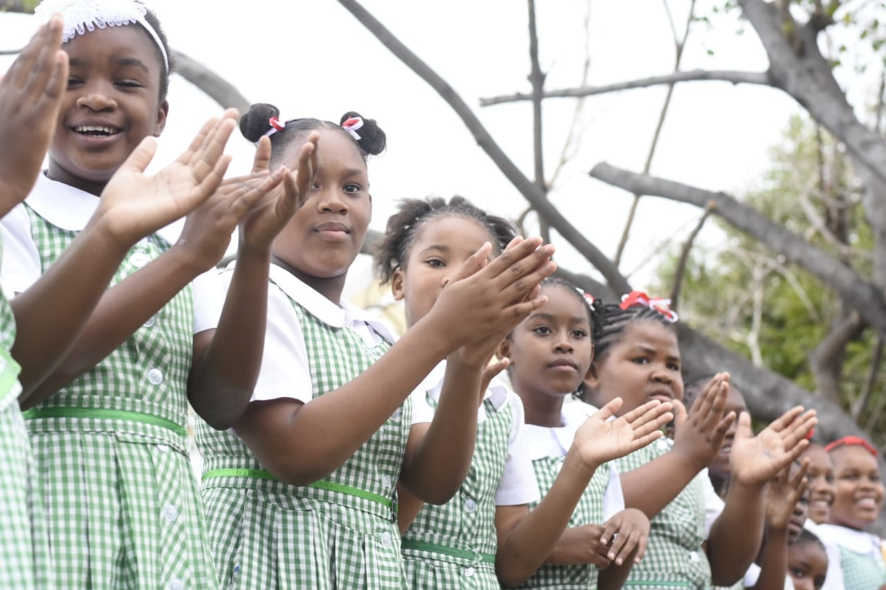 St George's Primary School students clap as they observe the pageantry during the ceremonial opening of Parliament along Duke Street in downtown Kingston on Thursday. (PHOTO: Marlon Reid)