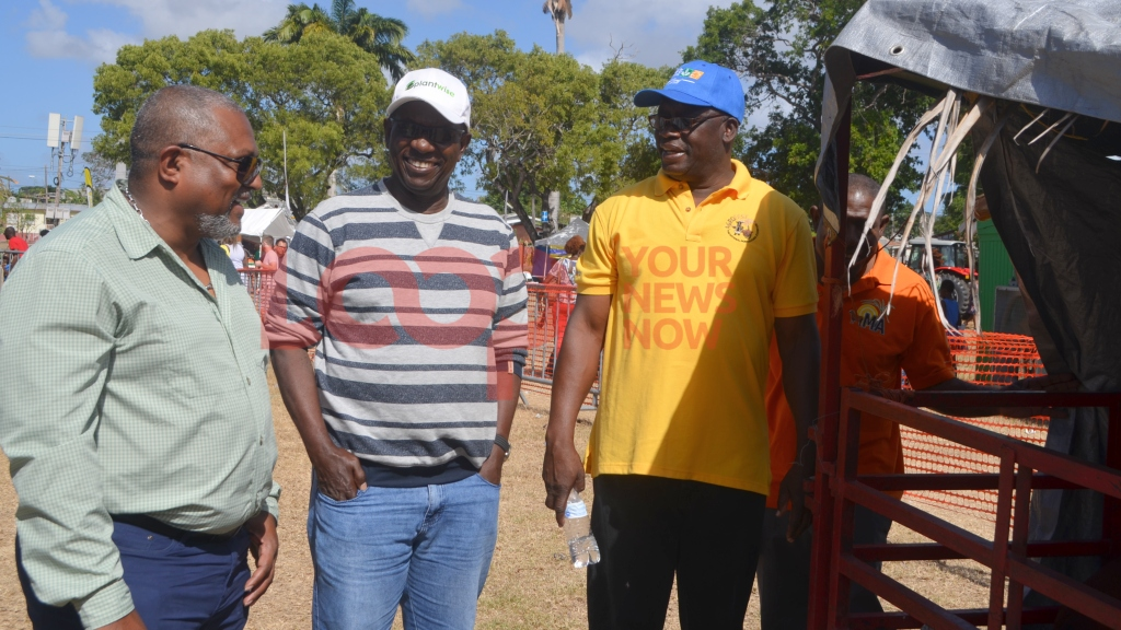 (left) Minister Indar Weir touring Agrofest 2019 on its final day.