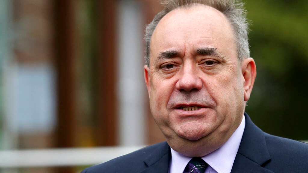 FILE - In this Thursday, Sept. 18, 2014 file photo, Scotland's First Minister Alex Salmond poses for photographs in Turriff, Scotland. Media in Scotland say the country's former leader, Alex Salmond, has been arrested and charged with an unspecified offense on Thursday Jan. 24, 2019. (AP Photo/Scott Heppell, file)