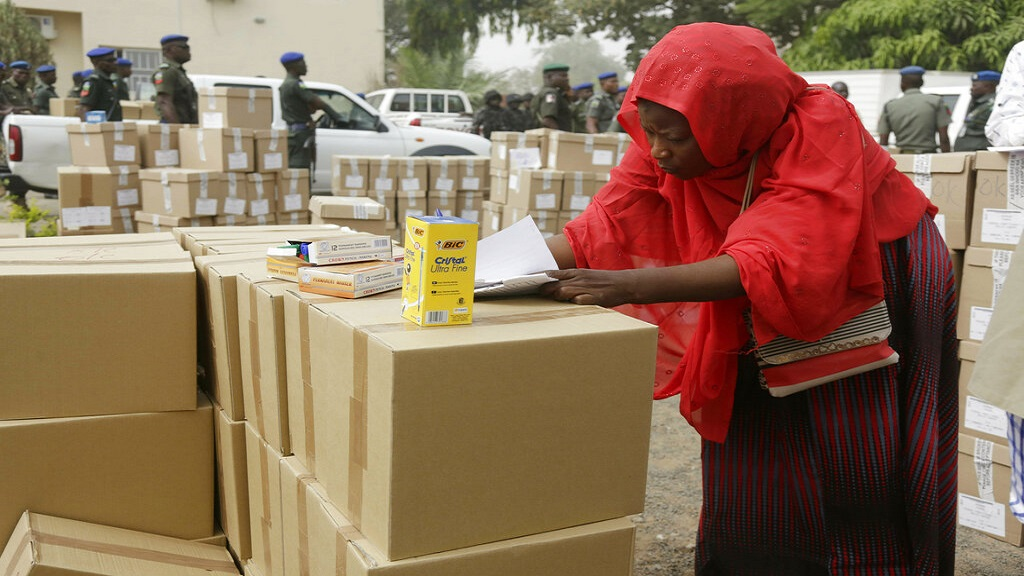 An electoral worker takes stock of ballot papers to be transporters at the offices of the Independent National Electoral Commission in Yola, Nigeria. (AP Photo)