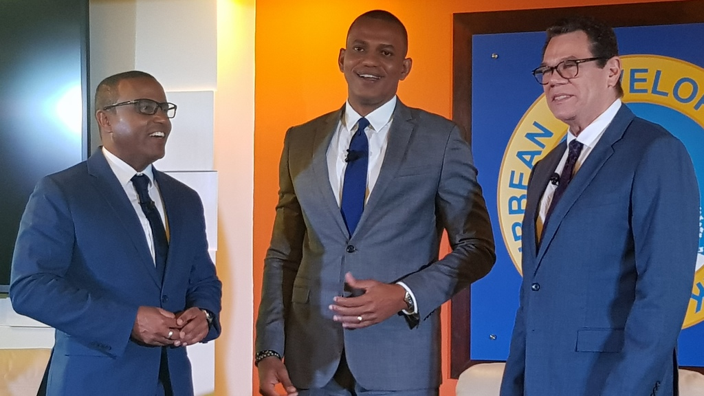 From left, Dr. Justin Ram, Director of Economics, Dr Daniel Best, Director of the Projects Department and Dr William Warren Smith, President of the CDB