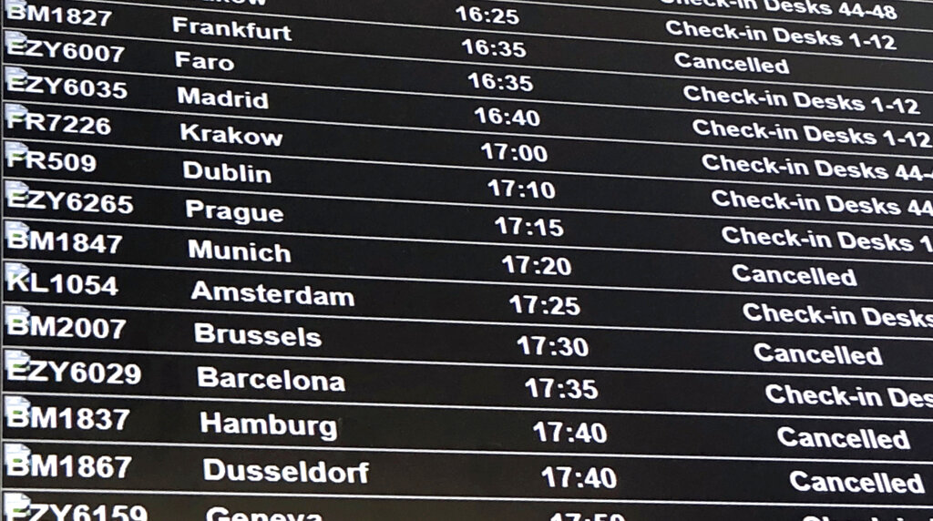 A departure board showing the BMI flights cancelled following the collapse of the airline, at Bristol Airport in Bristol, England, Sunday, Feb. 17, 2019. Hundreds of passengers have been stranded by the abrupt collapse of the British regional airline Flybmi. The airline says it's filing for administration _ a British version of bankruptcy because of higher fuel costs and uncertainty caused by Britain's upcoming departure from the European Union. (PA via AP)
