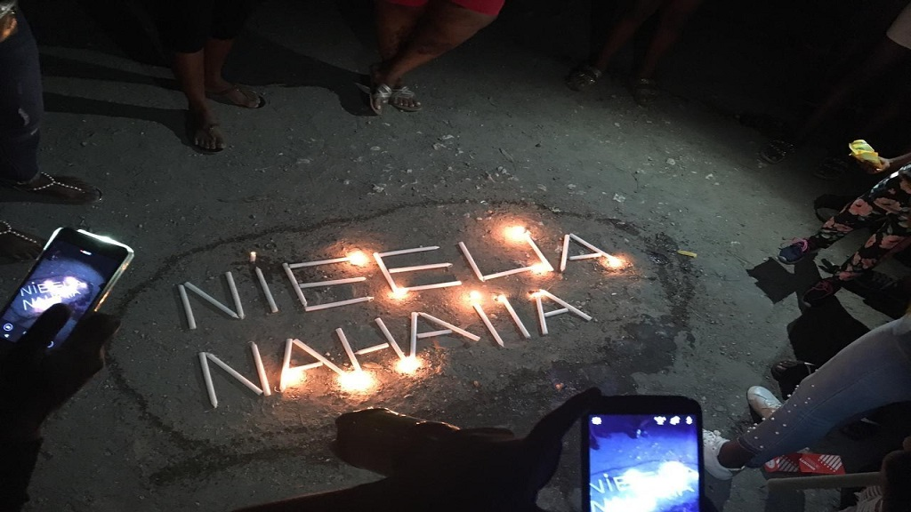 A highly emotional and creative depiction that marked a candlelight vigil for two-year-old twins, Nahaila and Nieelia Pinnock, in Grants Pen, St Andrew on Friday, a week after they perished in a fire in the community. (Vigil photos: Marlon Reid)