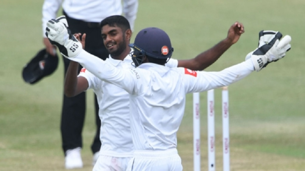 Lasith Embuldeniya celebrates a wicket.
