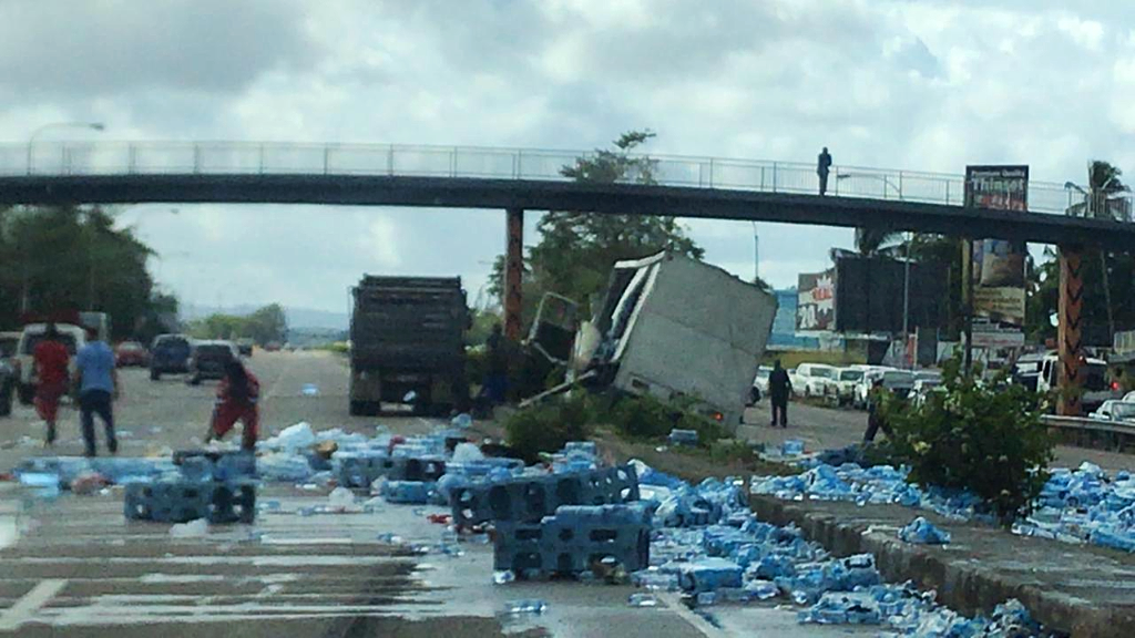 Photo: A truck carrying crates of bottled water collided with a PTSC bus on February 5, 2019. As a result of the accident, two female passengers died.