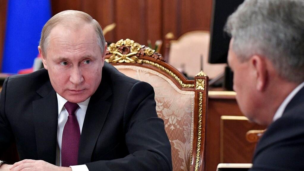 Russian President Vladimir Putin, left, speaks to Defense Minister Sergei Shoigu during a meeting in the Kremlin in Moscow, Russia, Saturday, Feb. 2, 2019. (Alexei Nikolsky, Sputnik, Kremlin Pool Photo via AP)