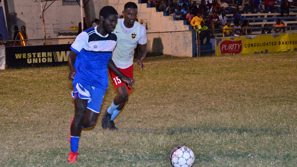 Brown's Town FC's Romario Ward (left) dribbles away from Central Kingston FC's captain, Donovan Alvaranga, during their first round Magnum KSAFA Super League football match at Harbour View Mini Stadium. Brown's Town won 1-0.