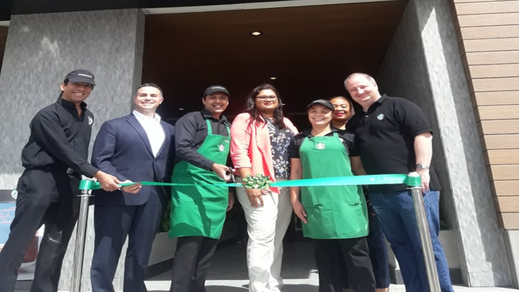 From left to right: Shane Lue Choy Marketing Manager, Jose Castro Starbucks District Manager, Mitchell McLeod Store Manager, Kerri Hosein-Khan Vice President Starbucks, Theresa Butcher Assistant Store Manager, Nesha Malchan Partner Resources Manager, Simon Hardy CEO.