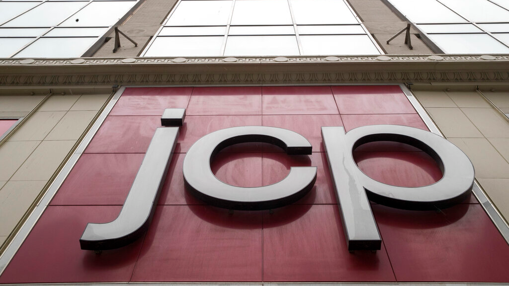 FILE - In this May 16, 2018, file photo, the J.C. Penney logo is seen hanging outside the Manhattan mall in New York. J.C. Penney Co. reports financial results Thursday, Feb. 28, 2019. (AP Photo/Mary Altaffer, File)
